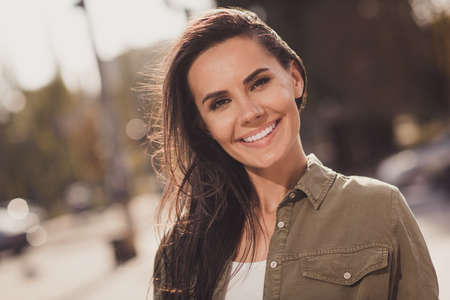 Photo portrait of gorgeous beautiful smiling woman looking at camera outside on street Stock Photo