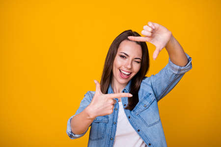 Photo of excited energetic girl make fingers imagine she photographing wink blink wear good look clothes isolated over shine color background