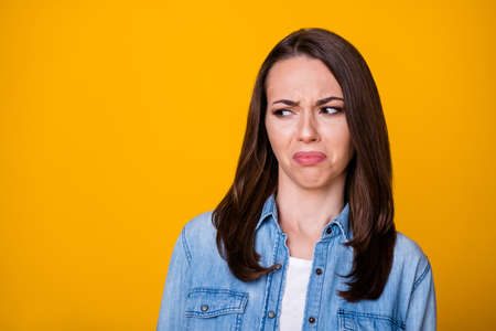 Portrait of frustrated girl look copyspace dislike spoiled scent wear casual style clothes isolated over vivid color background Foto de archivo