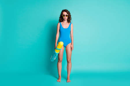 Full length photo of girl rest relax friend pool party want win water gun fight battle wear blue bodysuit isolated over teal color background