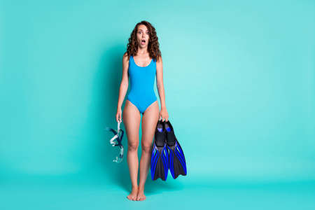 Full length body size view of her she attractive worried girl holding in hands dive tools new active hobby learn isolated bright vivid shine vibrant teal turquoise color background
