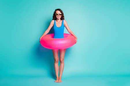 Full length body size view of her she attractive cheerful girl having fun wearing swimwear pink buoy resort enjoying exotic tourism isolated bright vivid shine vibrant blue color background