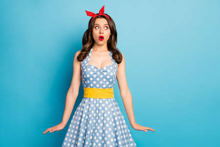 Portrait of astonished frustrated girl look copyspace impressed feel fear anxious nervous scream wow omg wear skirt isolated over blue color background
