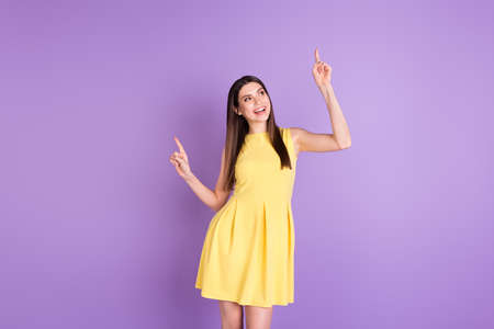 Portrait of attractive carefree cheerful girl dancing having fun chill out isolated over violet purple pastel color background