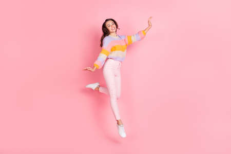 Full length body size view of pretty skinny cheerful girl jumping dancing having fun isolated over pink pastel color background