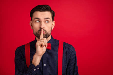 Photo of young handsome curious dreamy gentleman look copyspace cover moth silent isolated on red color background