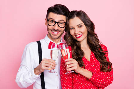 Photo of nice optimistic brown hair couple hold glasses wear trend cloth isolated on pastel pink color background