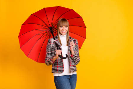 Photo of adorable person hand hold umbrella beaming smile look camera isolated on yellow color background