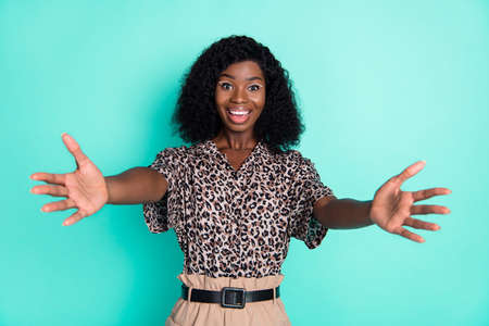 Photo of lovely friendly lady stretch hands look camera wear leopard print shirt isolated teal color background