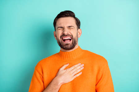 Photo of young cheerful man happy positive smile hand on chest laugh humor joke isolated over turquoise color background