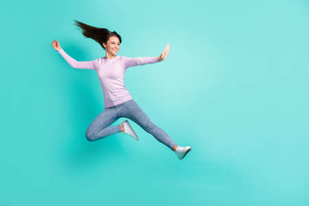 Full length body size view of pretty cheerful girl jumping dancing having fun hobby isolated over turquoise bright color background