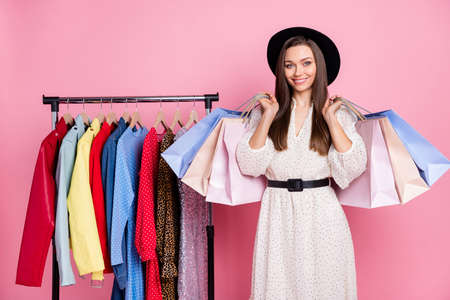Photo of cute charming young lady wear white outfit cap bought new dressed isolated pink color background