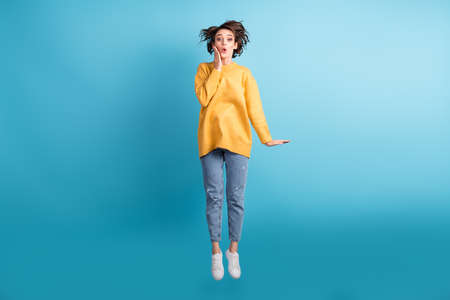 Full length body photo of amazed girl with short hairstyle touching cheekbones isolated on vibrant blue color background Stock Photo