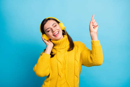 Portrait of charming cheerful dreamy girl listening soul single modern hip hop isolated over vivid blue color background Stock fotó