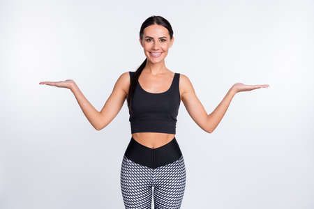Photo of brunette ponytail haired lady wear sports wear crop-top hold hands scales empty space isolated on grey color background