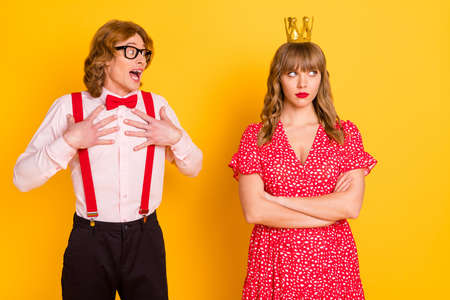 Photo portrait of funny geek amazed charmed with unhappy irritated girl valentines day isolated bright yellow color background
