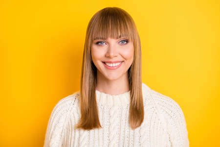 Photo of gorgeous person smile look camera wear sweater isolated on vibrant yellow color background