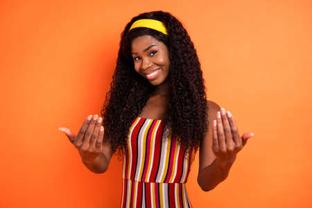 Photo of afro american attractive nice lady gesture come here you isolated on orange color background