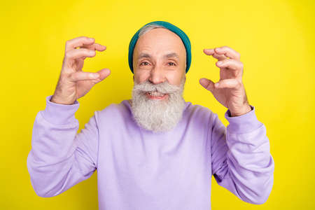 Photo portrait of elder man angry aggressive arguing isolated on vibrant yellow color background