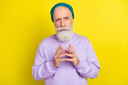 Photo portrait of serious smart aged man got idea thinking about plan isolated vivid yellow color background