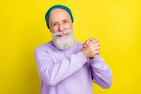 Photo portrait of aged man cheerful laughing gesturing like winner isolated vibrant yellow color background