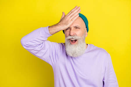 Photo portrait of aged man got problem stressed did mistake forgot isolated vibrant yellow color background Stok Fotoğraf