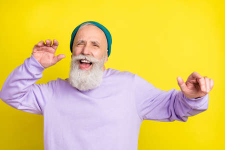 Photo portrait of aged man chilling relaxing dancing at party isolated bright yellow color background