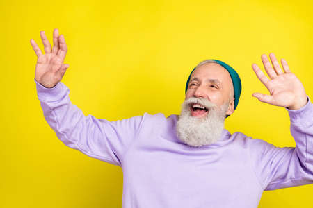 Photo portrait of aged man chilling relaxing dancing at party looking copyspace isolated vivid yellow color background