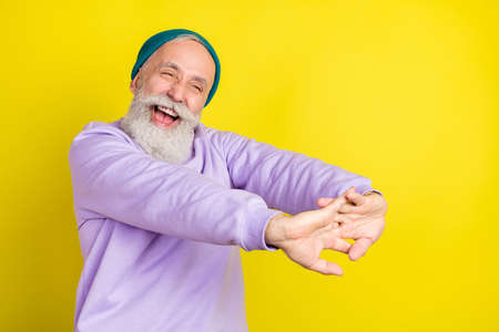 Photo portrait of aged man smiling having break rest looking copyspace isolated vivid yellow color background