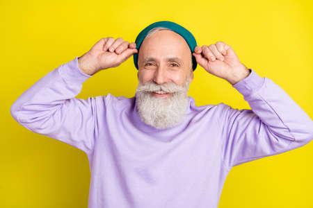 Photo portrait of aged man smiling wearing stylish outfit isolated vivid yellow color background