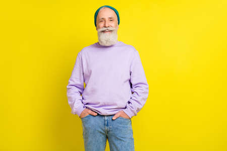 Photo portrait of aged bearded man happy smiling wearing trendy outfit headwear isolated bright yellow color background
