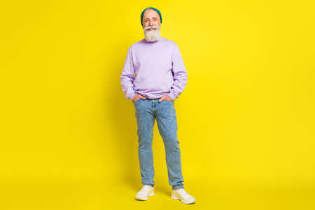 Full length body size photo of smiling elder man wearing stylish clothes isolated on bright yellow color background Stok Fotoğraf