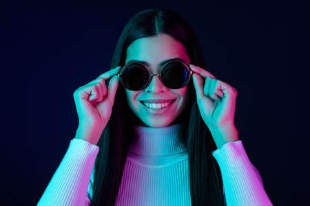 Photo of cool young millennial lady hands eyewear wear white sweater isolated on black dark color background