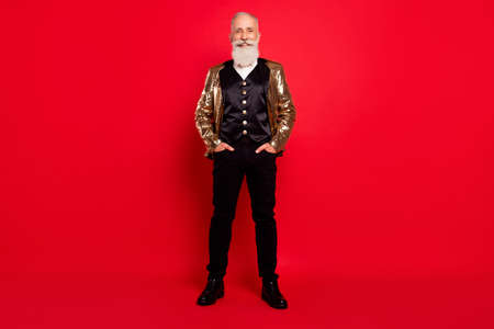 Full size photo of aged man happy positive smile confident wear costume showman isolated over red color background Foto de archivo