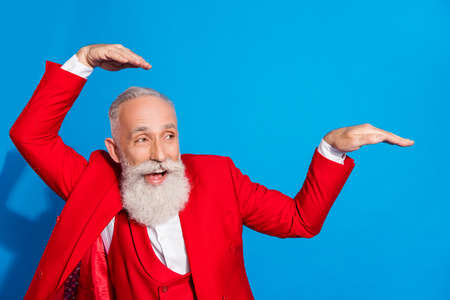 Photo of elederly cheerful man happy positive smile fooling playful dancer music lover isolated over blue color background