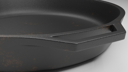 closeup of the handle of a skillet isolated on white with a few rust spots 3d illustration Reklamní fotografie