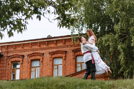 Reconstruction of traditional Russian dresses. Lovers in nature