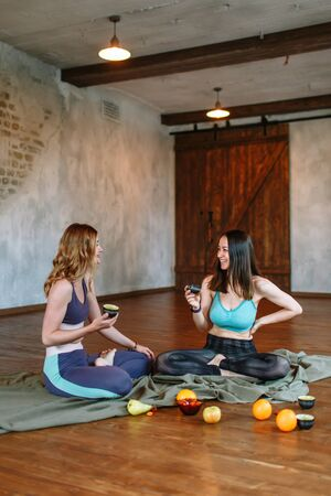 Conversation and tea party of two yogis in the loft