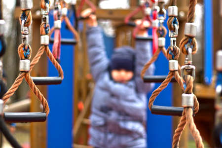 perseverance: child playing on a playground Stock Photo