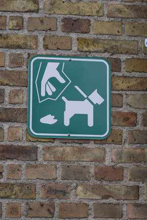 shit: Pet dog lover sign for remove dog shit from streets Stock Photo