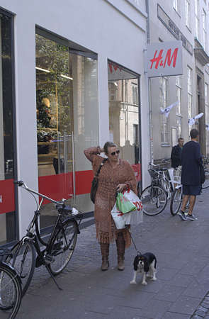 hm: DENMARK  COPENHAGEN . H&M home colection presentation ,female shoppers with H&M Hennes & Maruitz shoping bags 25 August 2010      (PHOTO BY FRANCIS JOSEPH DEAN  DEAN PICTURES)