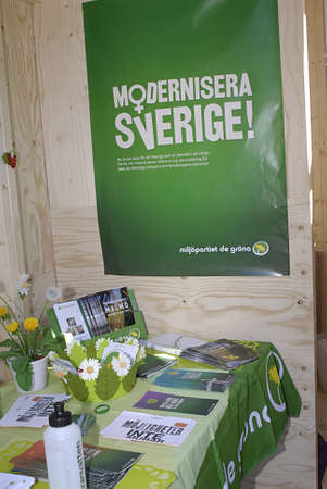 iquest: SWEDENMALMOEMALMOMALM&iuml,&iquest,&frac12, . Swedish riksday general parliament elections poster and party workers campaignelections stand and distributing informtionsn and posters  swedish elctions on 19 September 2010, campaign poster and workers wo