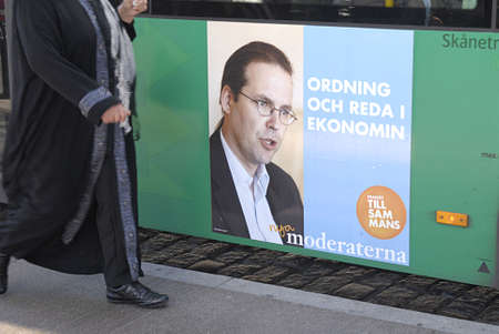 frac12: SWEDENMALMOEMALMOMALM&iuml,&iquest,&frac12, . Swedish riksday general parliament elections poster and party workers campaignelections stand and distributing informtionsn and posters  swedish elctions on 19 September 2010, campaign poster and workers wo