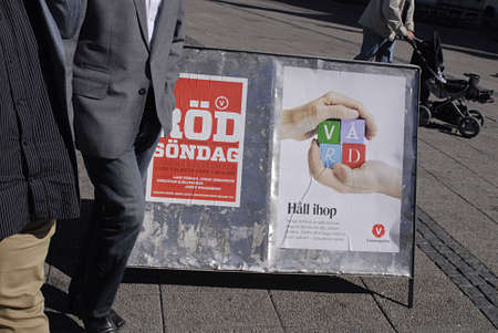 democrates: SWEDENMALMOEMALMOMALM&iuml,&iquest,&frac12, . Swedish riksday general parliament elections poster and party workers campaignelections stand and distributing informtionsn and posters  swedish elctions on 19 September 2010, campaign poster and workers wo