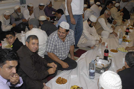 break fast: DENMARK  COPENHAGEN_ Pakistani immigrants living in Denmark break fast at 8.39 pm after prayer celebrate iftar evening ,iftar was given by Choudhary family father Choudhoury Asghar and son Choudhary Shafi  party was given at Ilsma Culature center Mosque