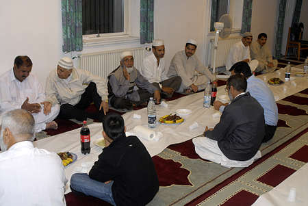 pakistani food: DENMARK  COPENHAGEN_ Pakistani immigrants living in Denmark break fast at 8.39 pm after prayer celebrate iftar evening ,iftar was given by Choudhary family father Choudhoury Asghar and son Choudhary Shafi  party was given at Ilsma Culature center Mosque
