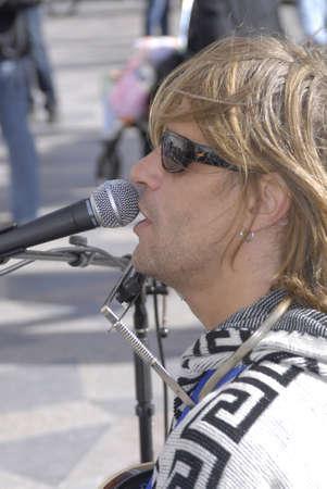 polictics: DENMARK  COPENHAGEN . STREET PREFORMER SINGINGAND ENTERTAINING PEOPLE ON STROGET TODAY ON SATURDAY 18 SEPT. 2010
