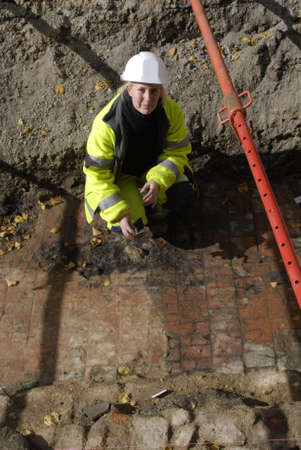 polictis: DENMARK  COPENHAGEN . Mie pedersen 29 years old arcologist from Copenhagen Museum digging Center of Copenhagen city at Hoejbroplads and has found old house floor in red bricks stone they have worked 3 weeks and 2 week more is work to do in future 1 Octob Editorial