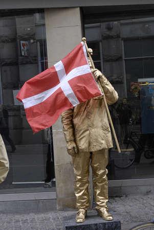polictis: DENMARK  COPENHAGEN .Dane hiding his face by danneborg 3 Octobeer 2010