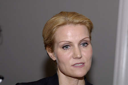 helle thorning schmidt: DENMARK  COPENHAGEN . Helle Thorning Schmidt leader of social democrat political party at Question Time andty Danish parliament session parliament member on first day at work after sommer vacation,some parliament questioning and some reading newspapers a